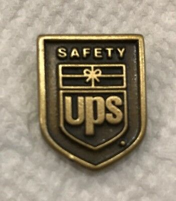 Vintage United Parcel Service Safety Lapel Pin With Large Retired Logo Shield.