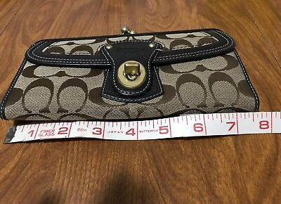 ... closeout coach legacy turnlock kiss lock beige khaki signature large  wallet. 07d28 c5b7e bbe275b51902d