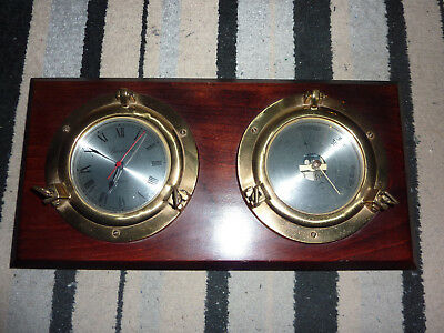 Ships Clock And Barometer-brass. Mounted on a wooden board. good condition