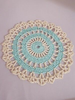 Aqua in Beige Bumblebee doily Approximately 5 Inches.
