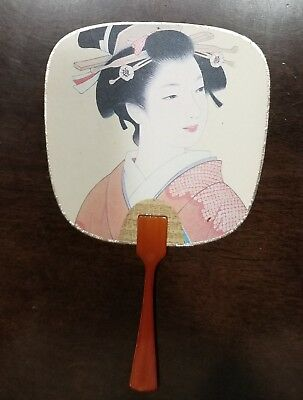 Hand-held fan portrays colorfully decorated Asian Geisha Girl