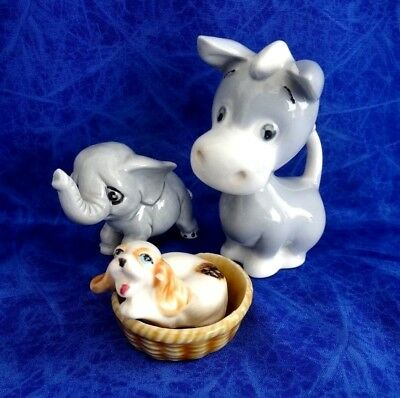 Three Vintage Ornaments A Donkey An Elephant And A Dog In A Basket