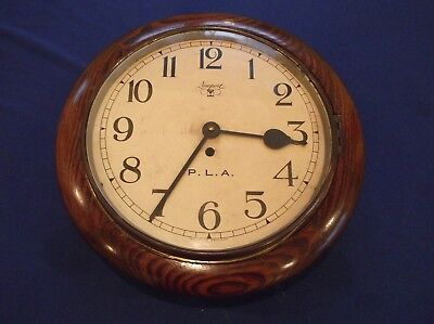 OAK CASED OFFICE DIAL CLOCK ex PORT of LONDON AUTHORITY, IN GOOD WORKING ORDER.