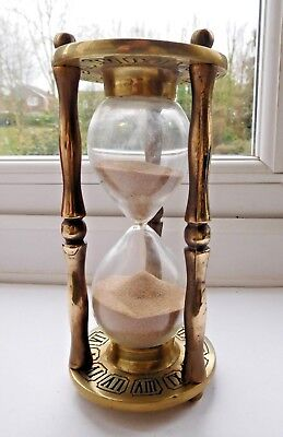 Vintage brass sand timer with old father time on top + zodiac & clock face base
