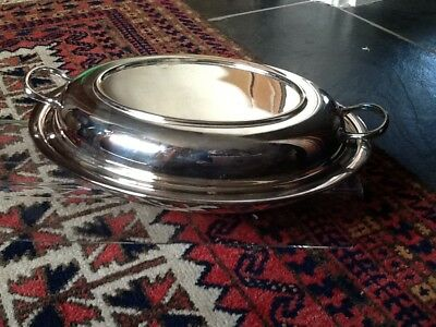 A vintage silver plated twin-handled lidded vegetable dish