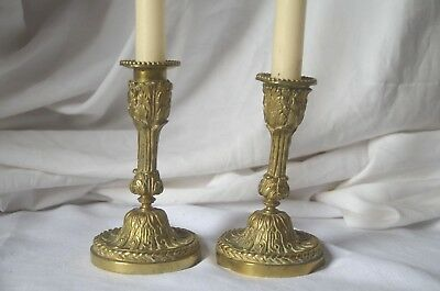 Pair of antique French 19th century solid bronze candlestick holders
