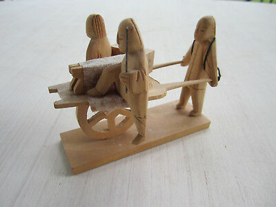 Small wooden figurine of 3 people and a loaded wheelbarrow - from China