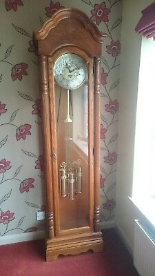 Howard Miller Brass Dial Longcase Grandfather Clock With Triple Chime Movement