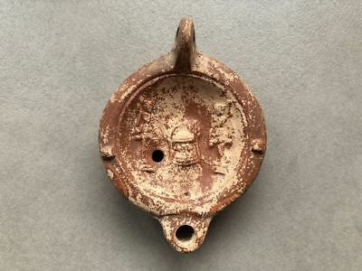 Roman pottery Oil Lamp 2nd century AD: Altar between two figures