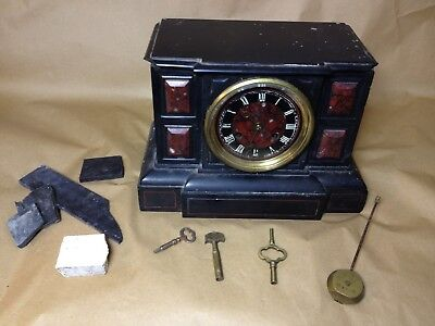 An old stone / marble clock with Made In Paris Le Roy et fils workings -
