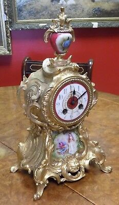 Antique Gilt Metal two train French Clock with Sevres style porcelain.