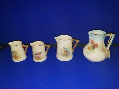 Four Royal Worcester Hand Painted Jugs  late 19th to mid 20th C  /Bird decorated