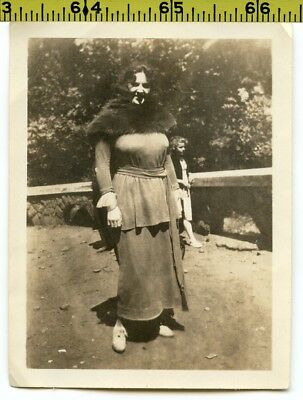 Vintage 1920's photo / Scary Buxom Young Woman Warms Mamms with Stolen Fur Stole