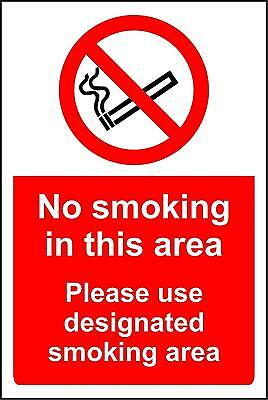 No Smoking in this area. Please use designated smoking area sign
