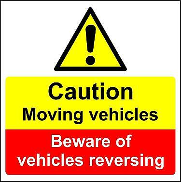 Caution moving vehicles beware of vehicles reversing sign