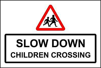 Slow down children crossing safety sign