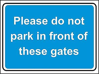 Please do not park in front of these gates safety sign