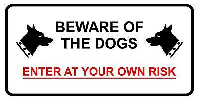 Beware of the dogs enter at your own risk safety sign