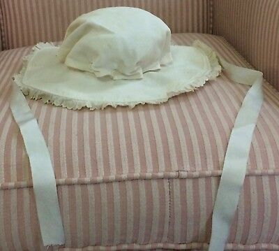 Antique child's hat, white ribbed fabric with buttons at the base of crown