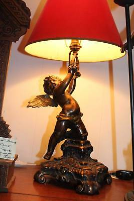 A Cast Bronze Angel Cherub Lamp with Shade