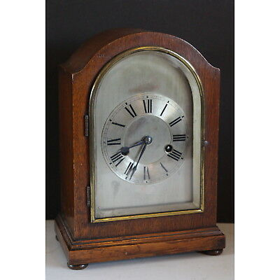 An Edwardian Oak Cased Dome Topped Mantle Clock with Silvered Dial and Chiming o