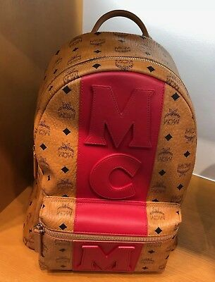 2fc904752323b7 Authentic Brand New MCM Stark Cognac Logo Red Stripe Backpack in Visetos