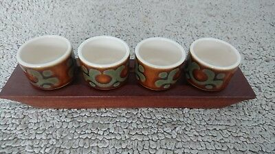 Hornsea Bronte egg cups on wooden tray