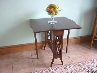Antique inlaid  mahogany Sutherland table from the late Victorian period.
