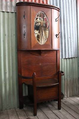 An Antique Blackwood Arts & Crafts Hall Stand with Lift Top Seat & Storage