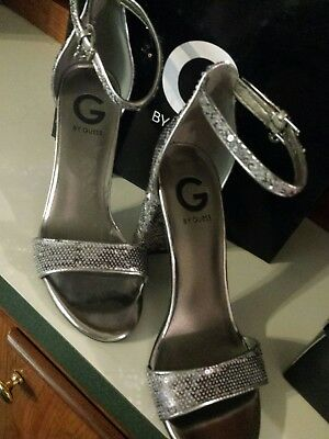 32b37c28e64 G by GUESS Shantel Silver Heels Ankle Strap Sandals Womens Shoes Size 7.5  NEW