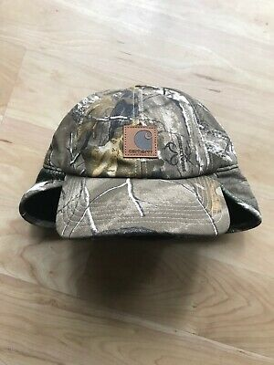 4ef35c619cc CARHARTT 101477C - Camo Ear Flap Cap - Real Tree 977 -  14.99
