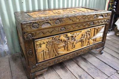 A Very Large Heavily Carved Oriental Camphor Wood Chest