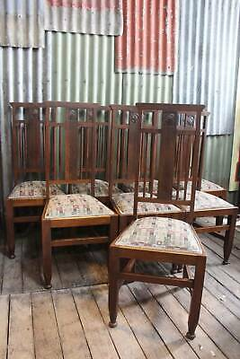 A Set of 8 Arts & Crafts Oak High Back Dining Chairs