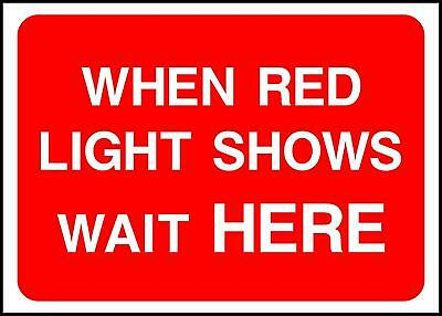 Warning When Red Light Shows Wait Here Road Safety Sign