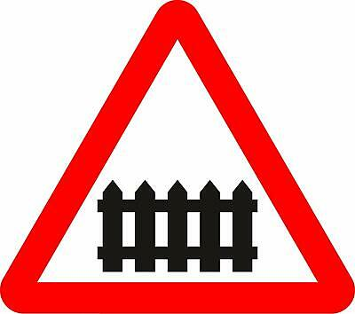 Level crossing with barrier or gate ahead Road safety sign