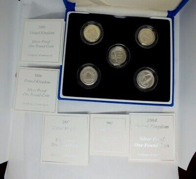 Case of five one pound silver proof coins from 2003- 2007 with all CoA.