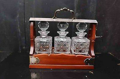 Silver plate and mahogany cased tantalus 3 cut glass decanters in perfect order