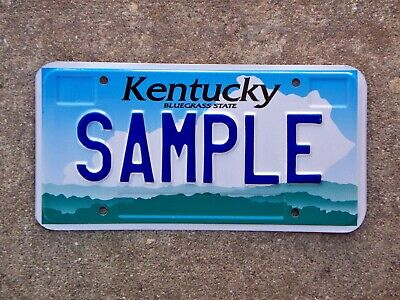 2000 Kentucky Sample License Plate Mint State Shaped Cloud With Hills and Sky