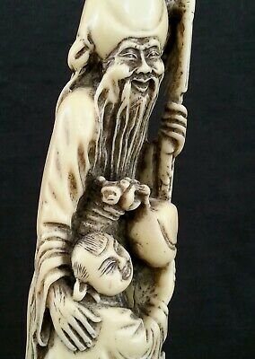 Antique Chinese hand carved hard resin figurine, 12.5 inches