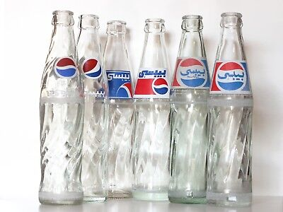 Set of SIX all different 1970s to 2000s Empty Pepsi Bottles from Amman Jordan