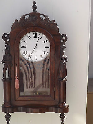 Wall clock American Pilgrim Fathers carved case in mahogany.