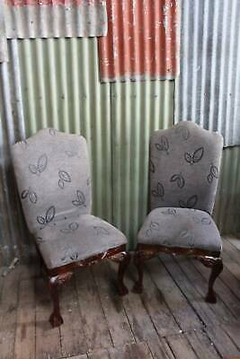 A Pair of Carved & Upholstered High Back Chairs with Ball & Claw
