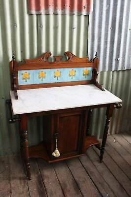 A Stunning Art Nouveau Marble Top Washstand with Tiled Back