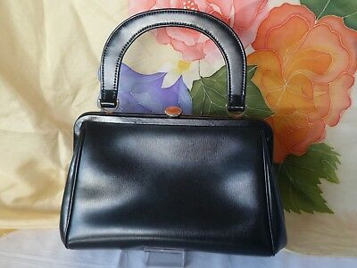 Vintage 1950s Gold Crest, black simulated leather bag, wrist handle, nice clasp