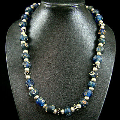 An Islamic Fustat (Cairo) glass eye bead necklace with later Islamic silver y849