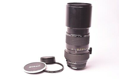 Lens Nikon Nikkor f/4.5 - 300mm. #498813. With filter and plugs