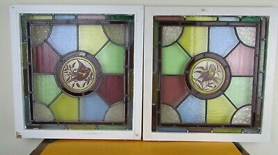 Two leaded Antique lead stained glass window panels hand painted with birds