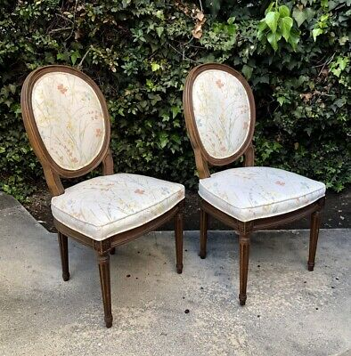 "A Pair of Carved Medallion Side Chairs by ""Henderon"""