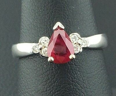 Lady's 14k white gold genuine pear shaped Ruby and Diamond ring