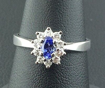 Lady's 14k white gold genuine Tanzanite and diamond cluster ring